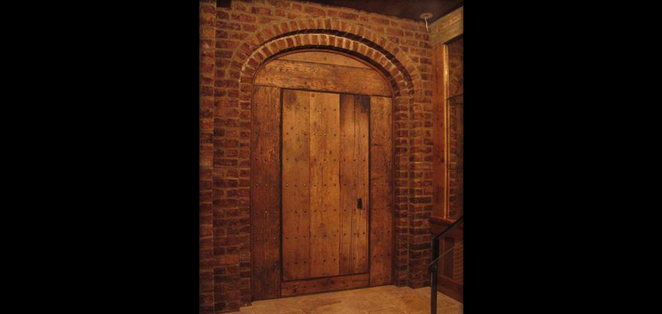 Rustic door fabricated from reclaimed New England barn flooring