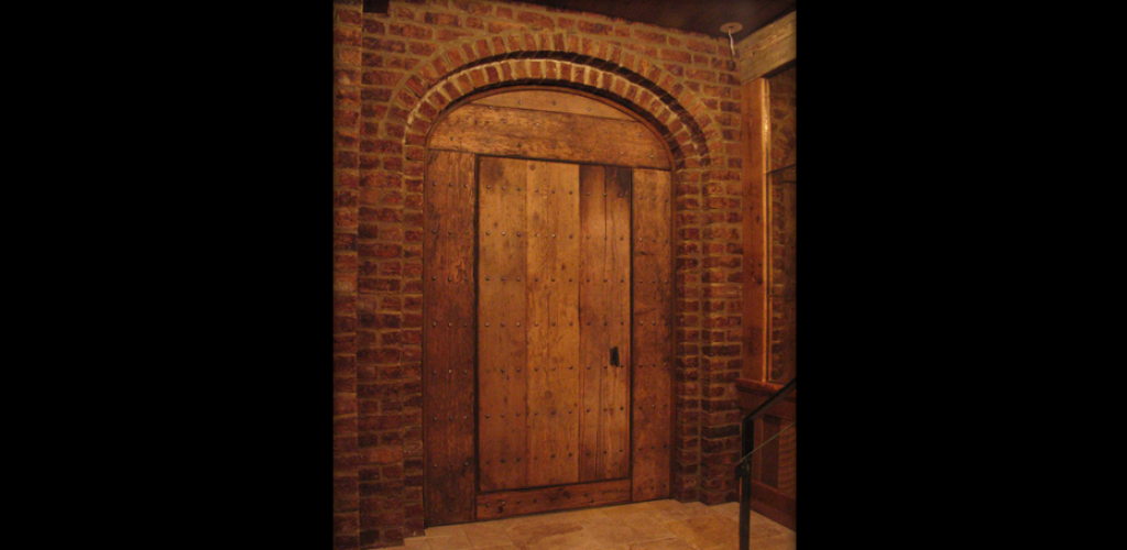 Rustic door fabricated from reclaimed New England barn flooring