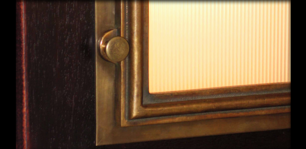 Detail of cast bronze sconce